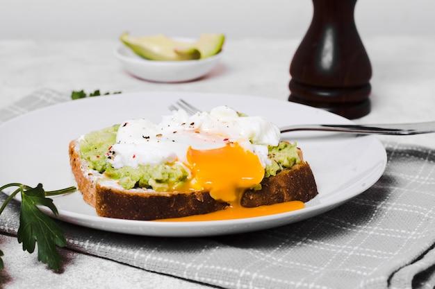 Egg on top of avocado toast Free Photo