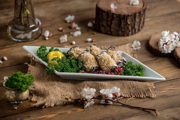 Eggplant roulets on the table Free Photo