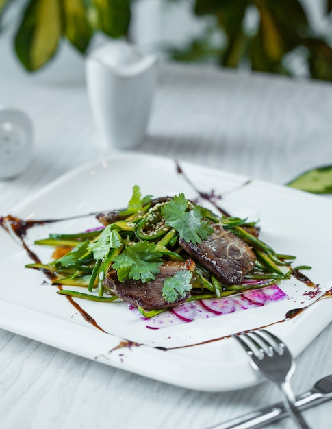 Eggplant salad with ruccola in the plate Free Photo