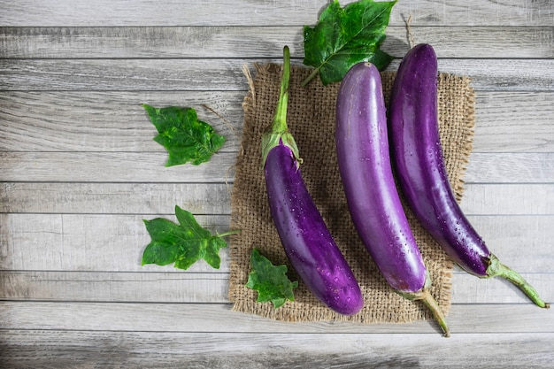 Eggplant on a wooden background Premium Photo
