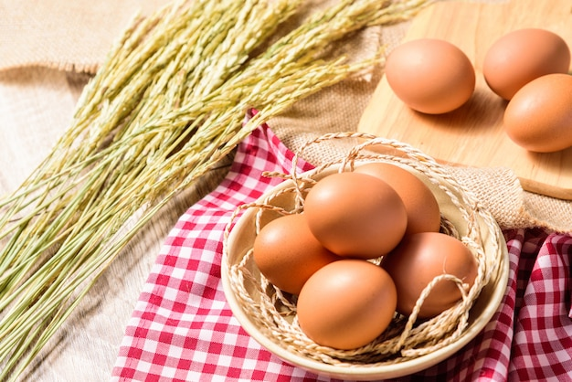 Eggs are placed in a white bowl Premium Photo