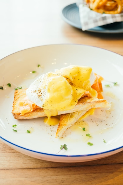 Eggs benedict with smoked salmon for breakfast Free Photo