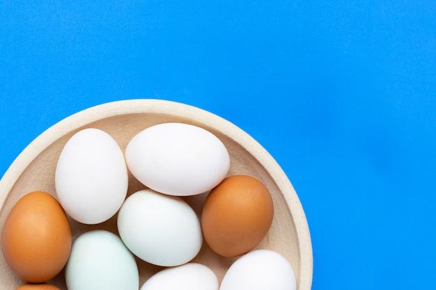 Eggs on blue. Premium Photo