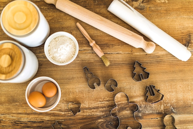 Eggs, flour, rolling pin andforms for biscuits Free Photo