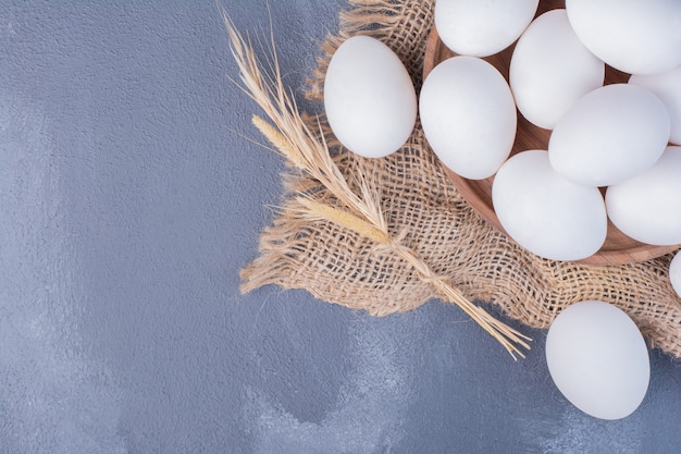 Eggs on a piece of rustic burlap. Free Photo