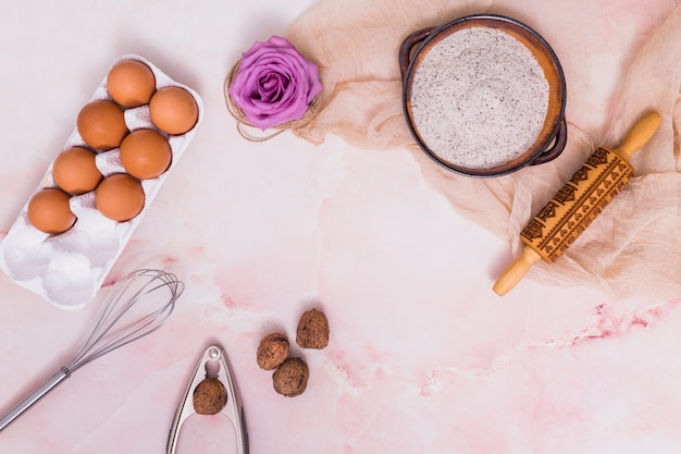 Eggs in rack with flower and kitchen utensils Free Photo