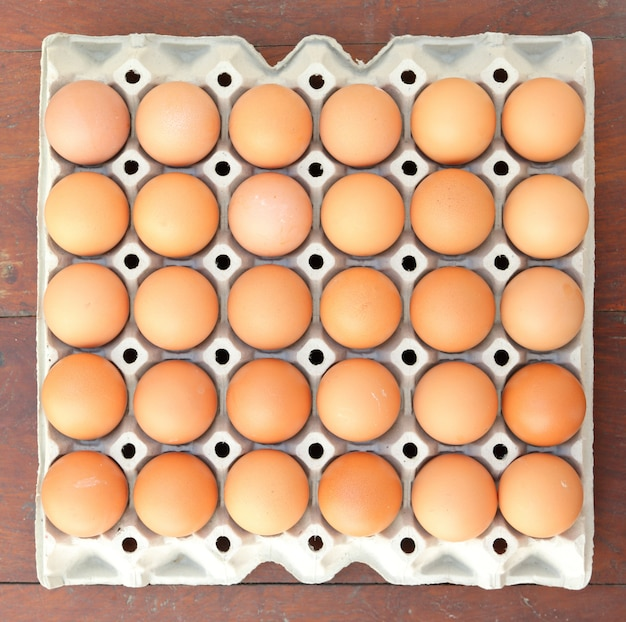 Eggs in tray, top view. Premium Photo