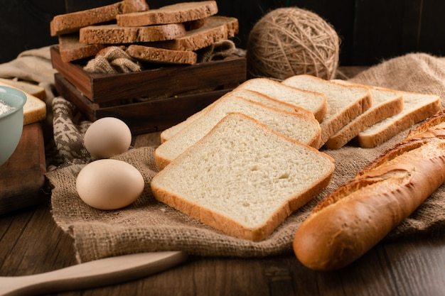 Eggs with slices of bread and french baguette Free Photo