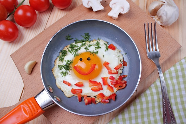 Eggs with tomatoes on the table Premium Photo