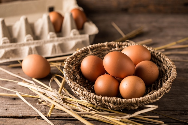 Eggs on wooden table background Premium Photo