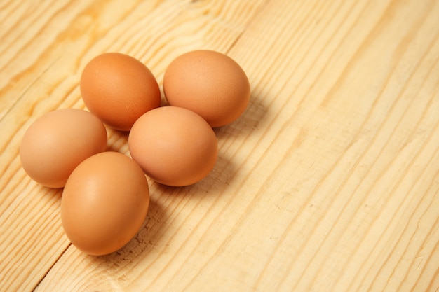 Eggs on a wooden table. top view Premium Photo