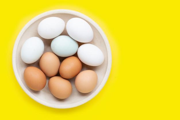Eggs on yellow. Premium Photo