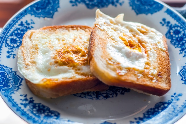 Eggy Bread On The Plate Photographed With Natural Light Golden French Toast With Butter