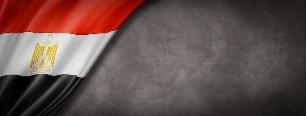 Egyptian flag on concrete wall banner Premium Photo
