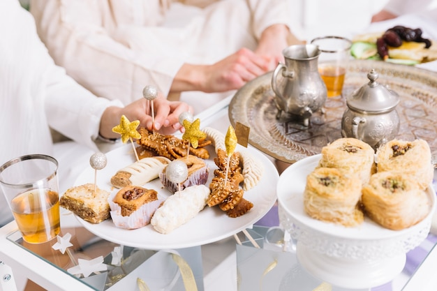 Eid al-fitr concept with arab food and friends Free Photo