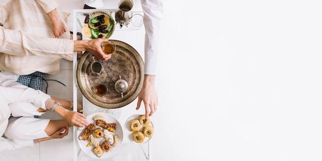 Premium Photo | Eid al-fitr concept with tea and copyspace
