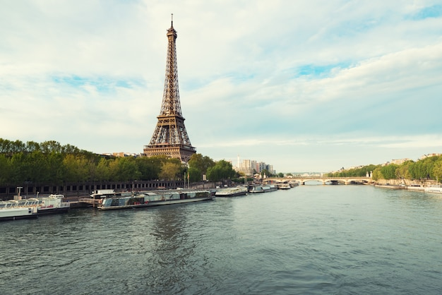 Eiffel tower in paris from the river seine in spring season. paris, france. Premium Photo