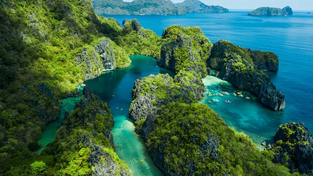 El nido, palawan, the philippines. aerial view of big lagoon, small lagoon and limestone cliffs Premium Photo