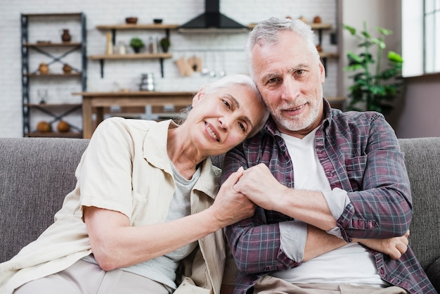 Elder couple posing for a photo Free Photo