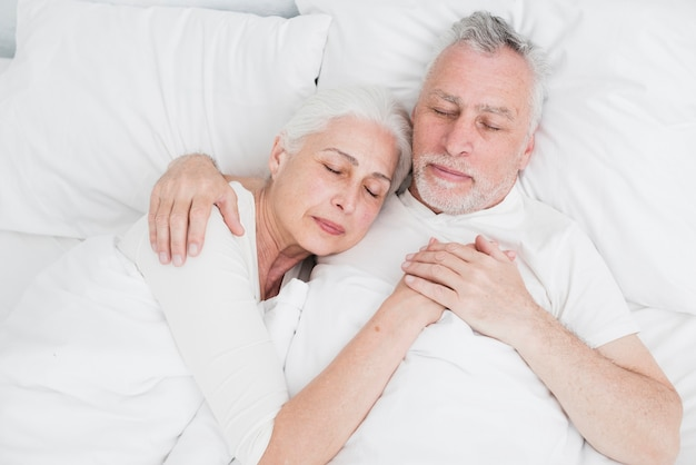 Elder couple resting in the bed Free Photo