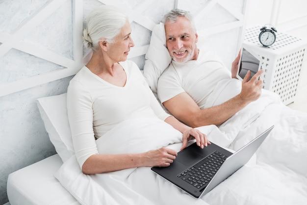 Elder couple using a laptop Free Photo