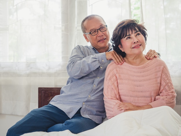 Elder man are massaging the shoulders for old woman Premium Photo