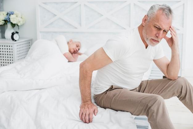 Elder man with a headache Free Photo