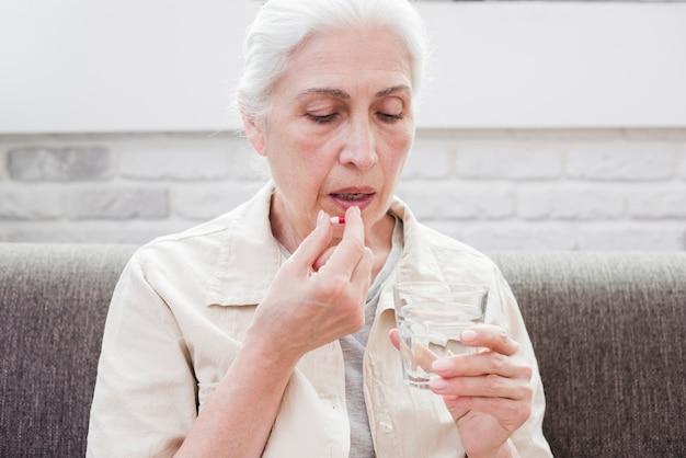 Elder woman having her medicines Free Photo