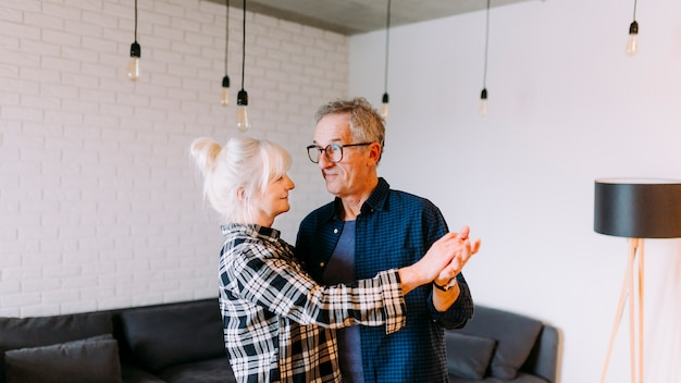 Elderly couple dancing in retirement home Free Photo