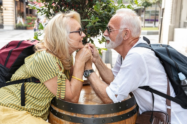 Elderly couple holding hands and looking at each other Free Photo