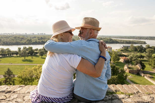 Elderly couple hugging each other Free Photo