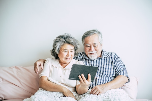 Elderly couple using tablet computer Free Photo
