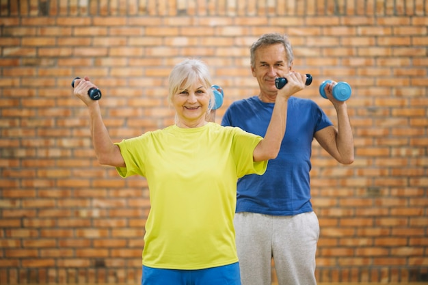 Elderly couple working out in gym Free Photo