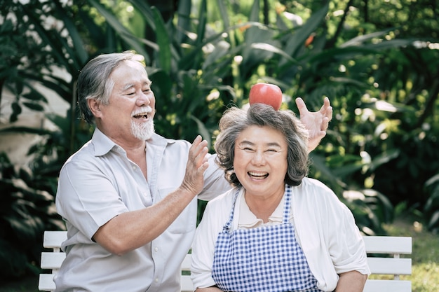 Elderly couples cooking healthy food together Free Photo