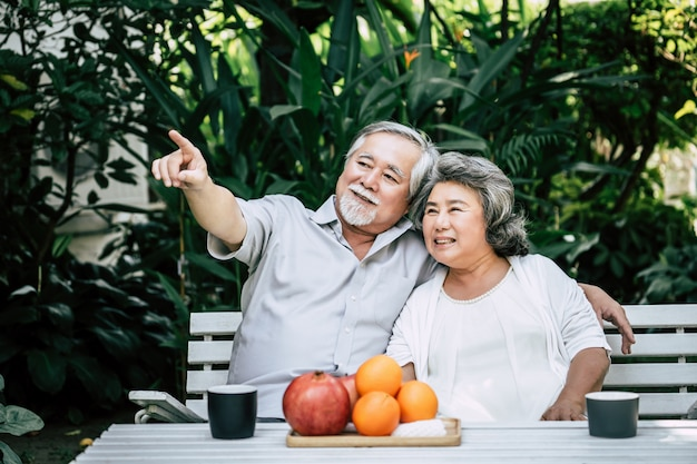 Elderly couples playing and eating some fruit Free Photo
