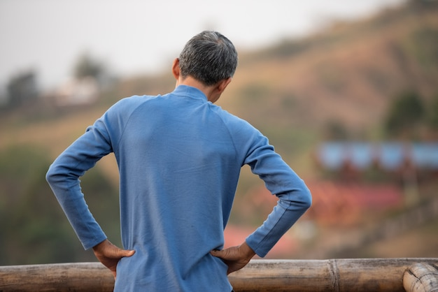 Elderly man exercising lightly at home Premium Photo
