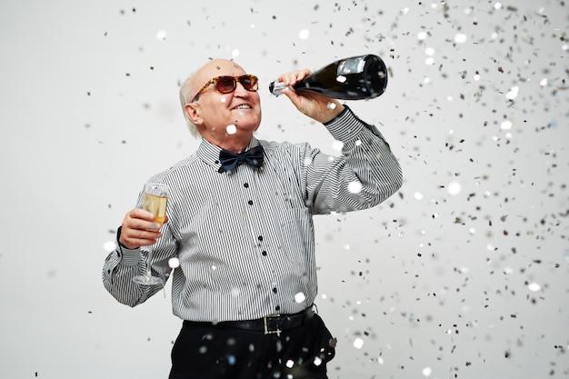 Elderly man recalling youth Free Photo