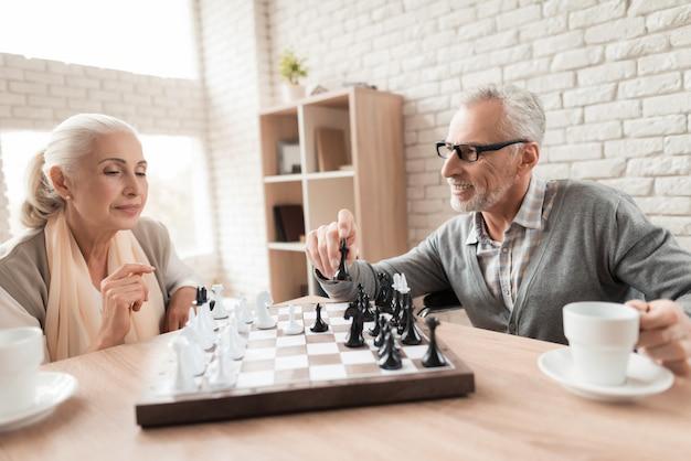 Elderly people play chess in nursing home. Premium Photo