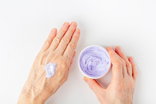 Elderly Woman Creaming Her Hands Close Up Cosmetic Moisturizing
