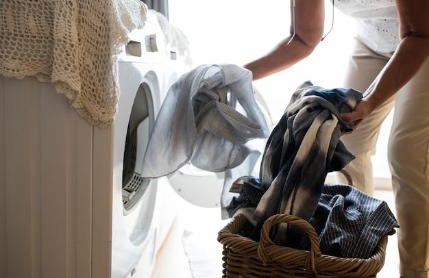 Elderly woman doing a laundry Premium Photo
