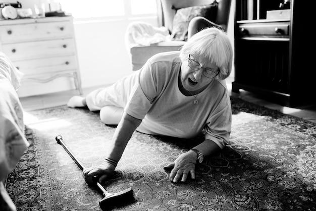 Elderly woman fell on the floor Free Photo