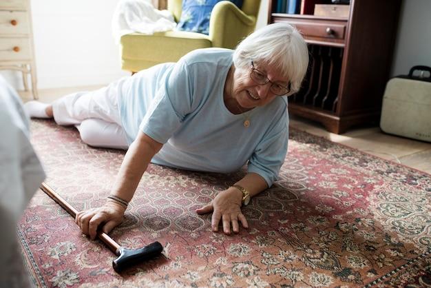 Elderly woman fell on the floor Premium Photo