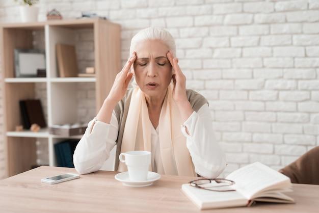 Elderly woman has headache. seniors health concept. Premium Photo