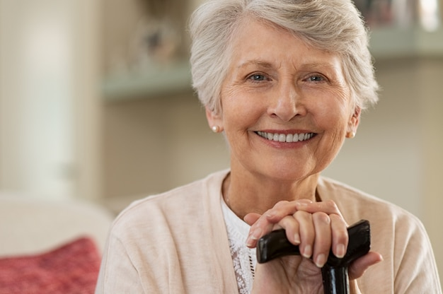 Elderly woman smiling at home Premium Photo