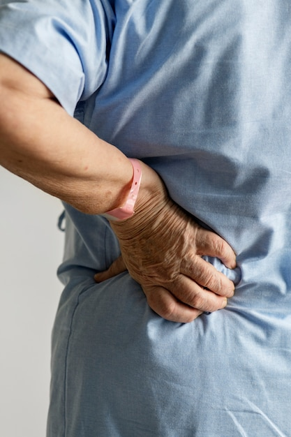 Elderly woman with back pain Free Photo