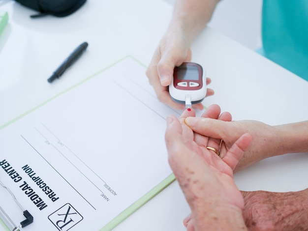 Elderly woman with blood testing in hospital. Premium Photo