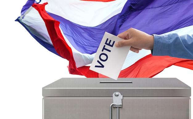 Elections in thailand, hand putting voting paper elections and democracy concept Premium Photo