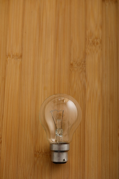 Electric bulb on wooden background Premium Photo