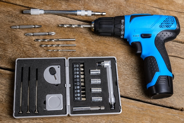 Electric drill on wooden table Premium Photo