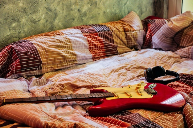 Electric Guitar And Headphones In Bedroom Films Grain Filter Photo